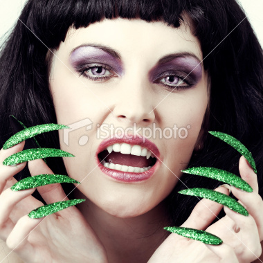 Ist2_10597566-halloween-woman-face-witch-vampire-with-her-green-nails